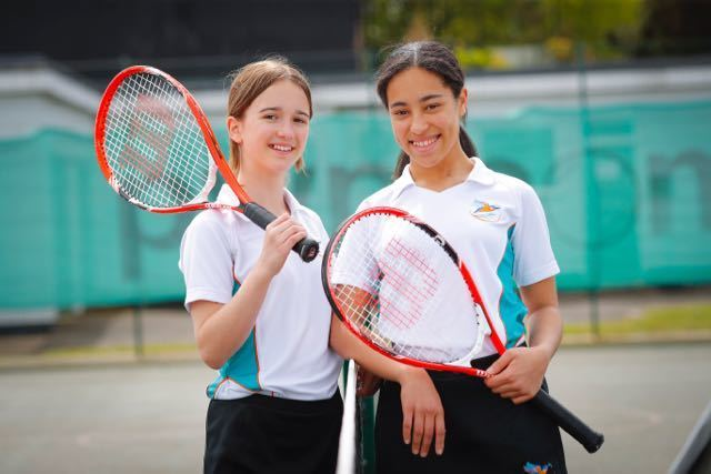 Students playing tennis